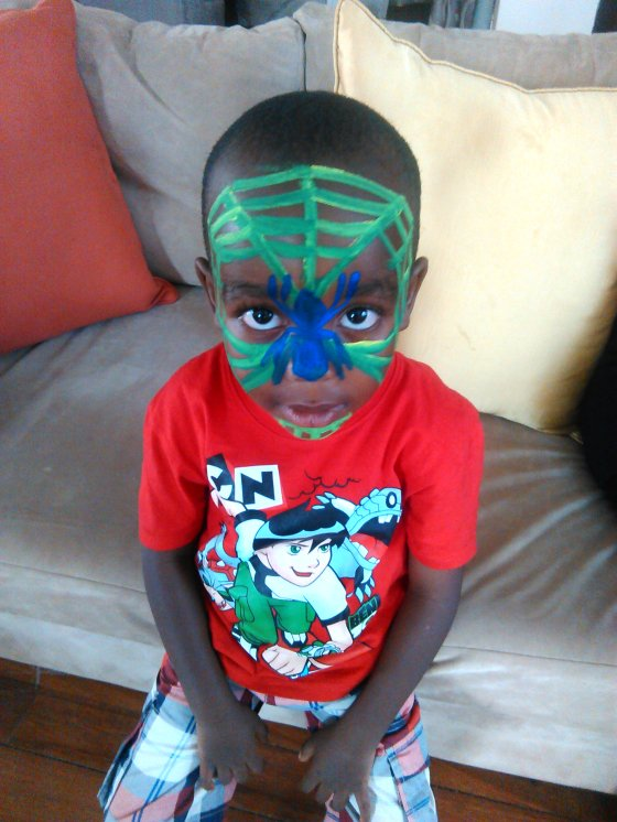 Staying true to both his heroes- a Spiderman face in a Ben 10 shirt.